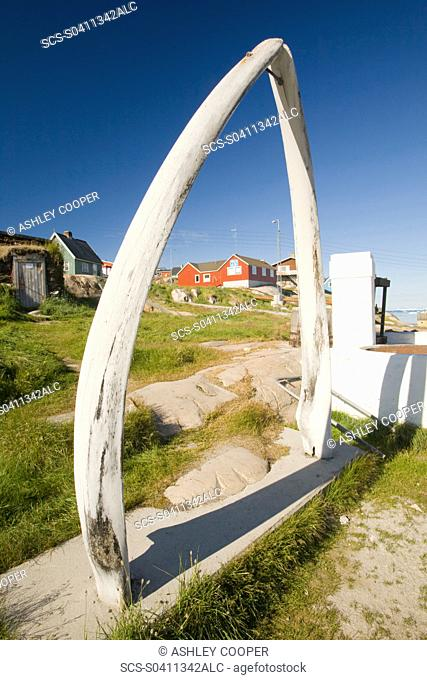 A whale bone arch and old vats for rendering down whale blubber in Ilulissat on greenland