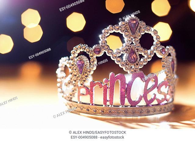 Princess tiara toy sparkling against background bokeh lights