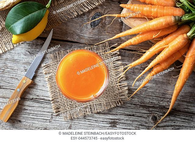 A glass of fresh carrot juice, top view