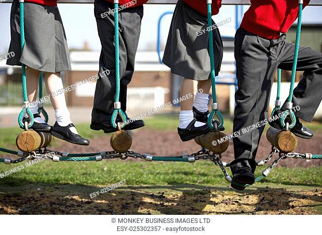 Close Up Of Elementary School Pupils On Climbing Equipment