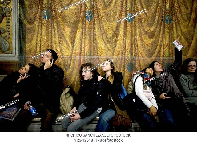 Tourists look at the ceiling of the Sistine Chapel in the Vatican Museum in Vatican City, Rome  The Sistine Chapel was built between 1471 and 1484 in the times...