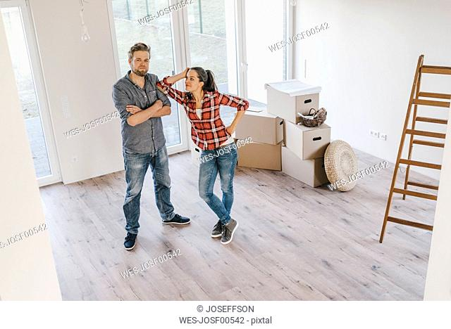 Couple standing in their new home