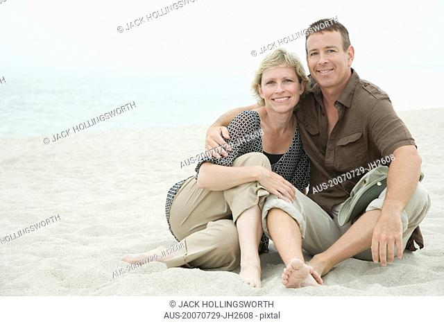 Portrait of a mature couple sitting on the beach