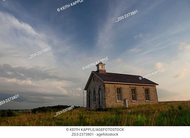 Abandoned Scholl house at sunset in Kansas