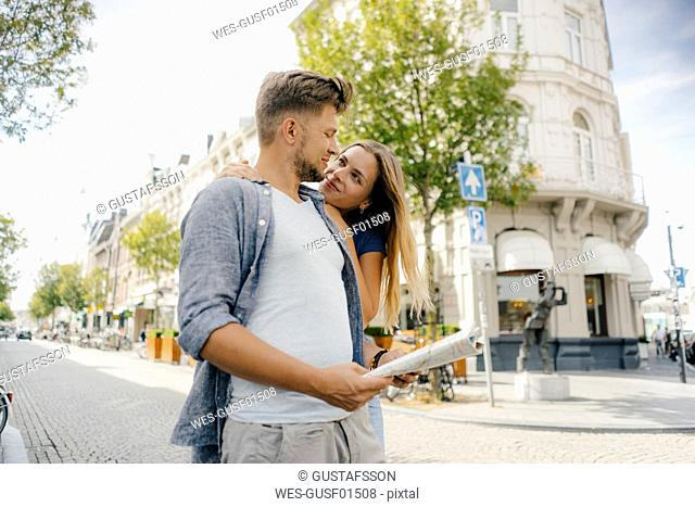Netherlands, Maastricht, happy young couple exploring the city