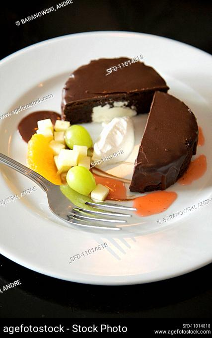 Halved Ring Ding on a White Plate with Fruit