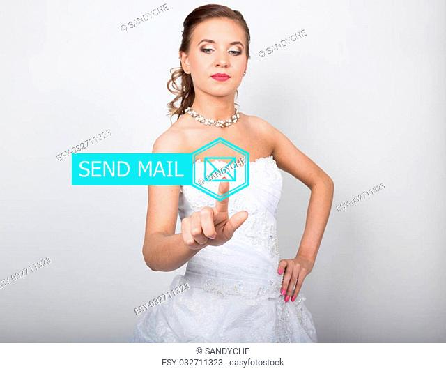 technology, internet and networking concept. Beautiful bride in fashion wedding dress. Bride presses sand mail button on virtual screens