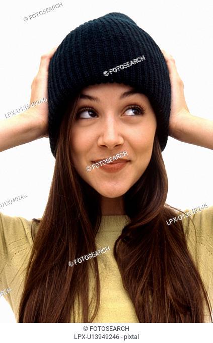 Caucasian female wearing beanie hat