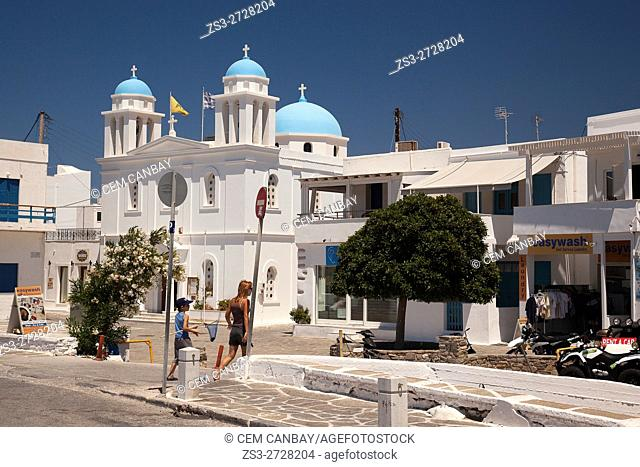 Mother and child in front of the blue domed church in Parikia, Paros, Cyclades Islands, Greek Islands, Greece, Europe
