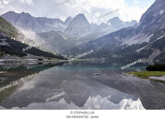 Mountains reflected in lake Seebensee, Ehrwald, Tyrol, Austria