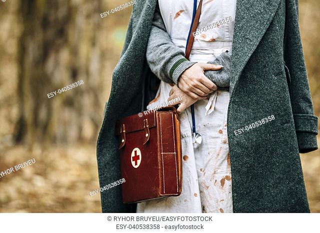 Unidentified re-enactor wears historical German nurse paramedic Of World War 2 uniform