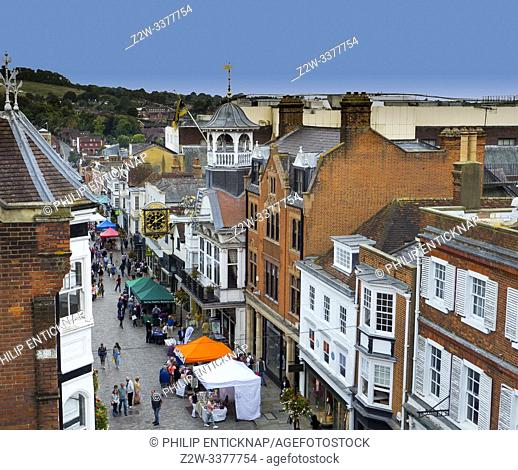 The Historic Guildhall and Town Clock in the High Street with Farmers market , Guildford, Surrey, England. Constructed in the 14th century