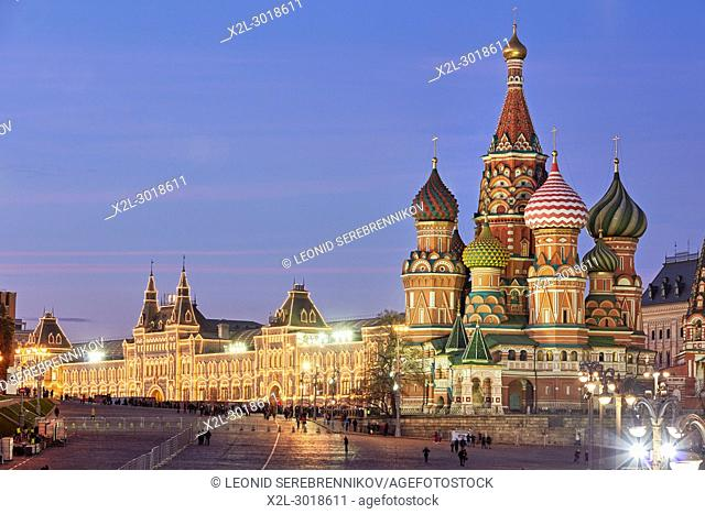 The Cathedral of Vasily the Blessed (Saint Basil's Cathedral) and illuminated building of GUM department store on the left. Red Square, Moscow, Russia