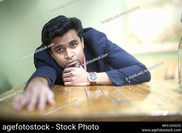 Indian man feeling melancholy