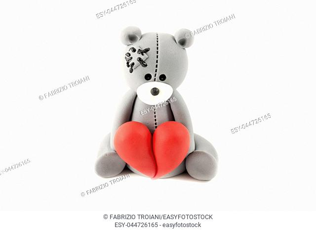 Edible sculpture of a bear in love on a white background