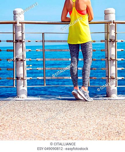 Look Good, Feel great! Closeup on young healthy woman in fitness outfit looking aside at the embankment