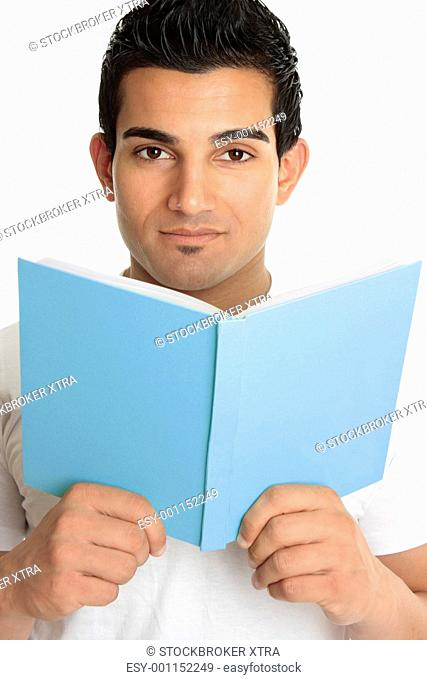 Man looking up from an open book