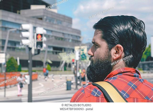 Spain, Bilbao, man waiting at red light