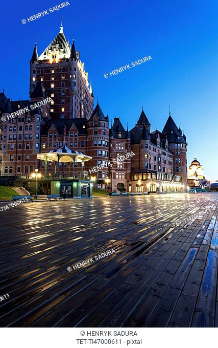 Illuminated Chateau Frontenac seen from boardwalk