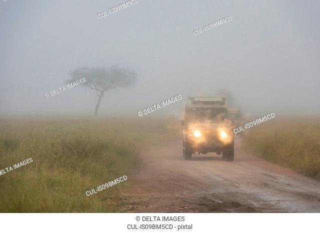 A safari vehicle driving in a rainstorm, Seronera, Serengeti National Park, Tanzania