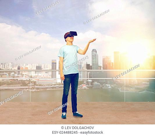 3d technology, virtual reality, entertainment, cyberspace and people concept - man with virtual reality headset or 3d glasses playing game holding something on...