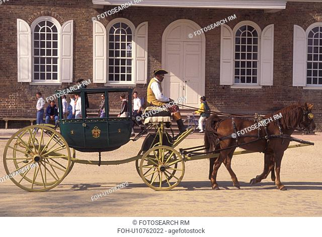 Colonial Williamsburg, horse-drawn carriage, Williamsburg, VA, Virginia, A team of horses pulling a covered carriage passes by the Courthouse in the 18th...