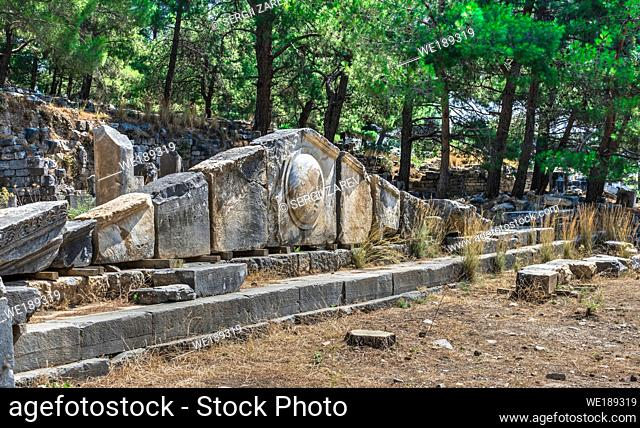 Ruins of the Ancient Theatre in the greek city of Priene in Turkey on a sunny summer day