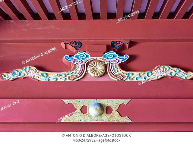 A decoration with shinto symbols on a building of Udo-Jingu shinto temple. Nichinan City. Miyazaki Prefecture. Japan