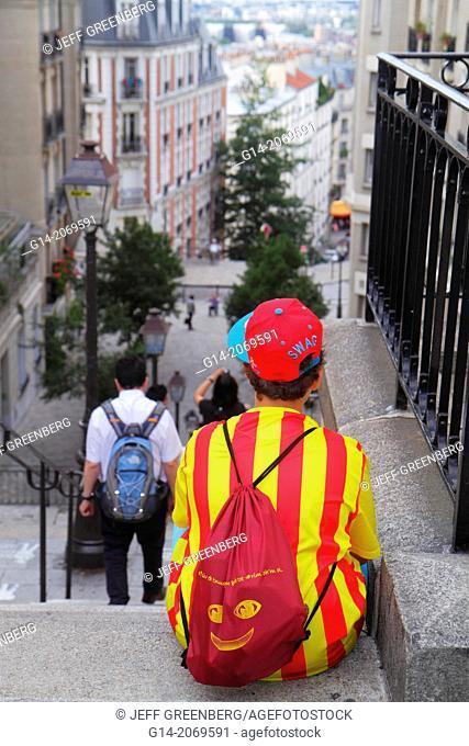 France, Europe, French, Paris, 18th arrondissement, Montmatre, Rue du Calvaire, Place du Tertre, boy, Spain colors, steps,