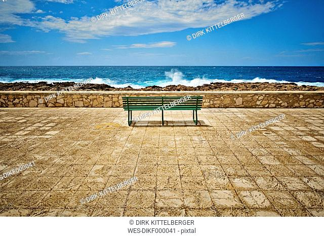 Italy, View of empty bench at beach