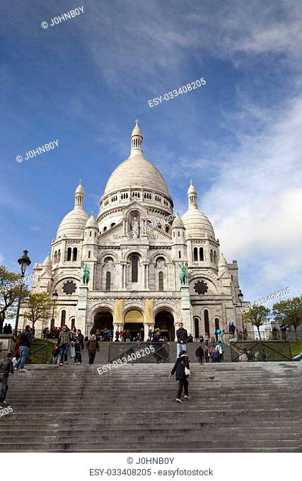 People walking up the stairs to Sacre Cour in Paris