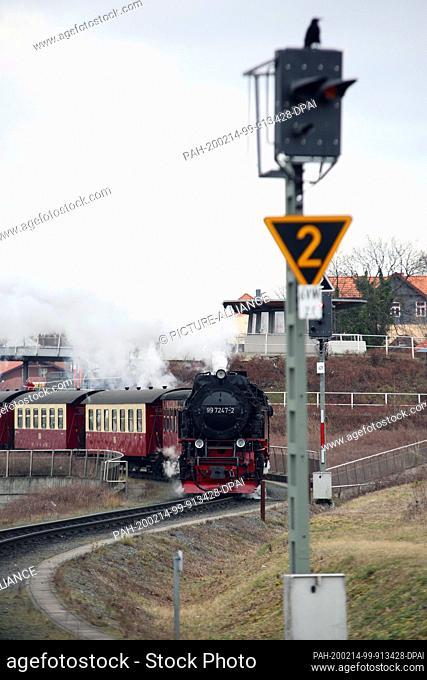13 February 2020, Saxony-Anhalt, Wernigerode: A train of the Harzer Schmalspurbahnen GmbH (HSB) departs from Wernigerode station