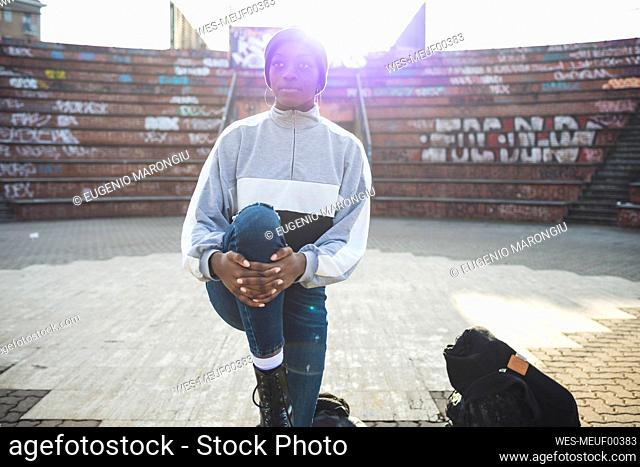 Young woman warming up in a skate park