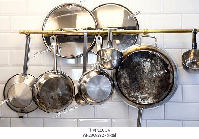Kitchen utensils hanging in kitchen
