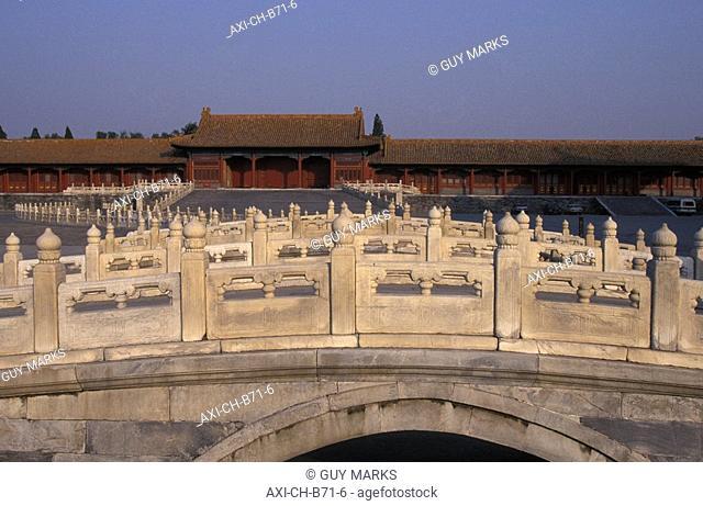 View through footbridge railings towards building in Forbidden City