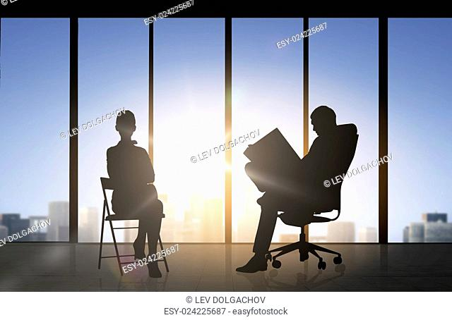 business, teamwork and people concept - silhouette of people working over office window background