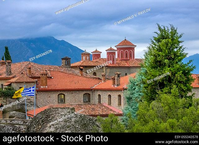 Greece. Summer cloudy day in Meteora. Red roofs and crosses on a greek monastery