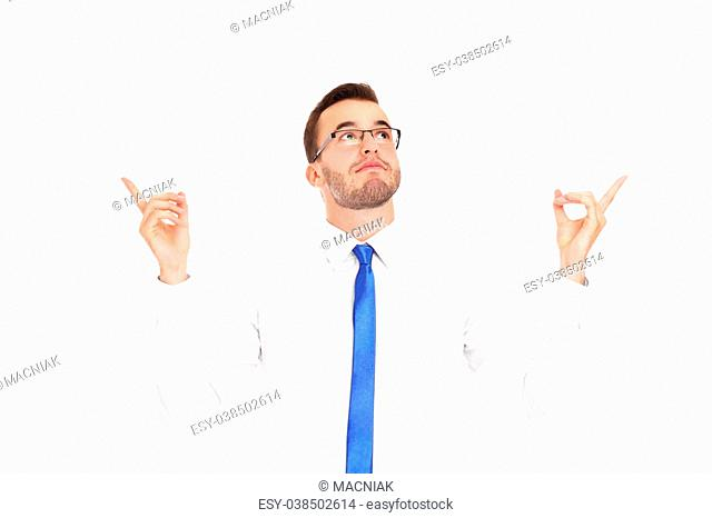 A picture of a young man pointing at something over white background