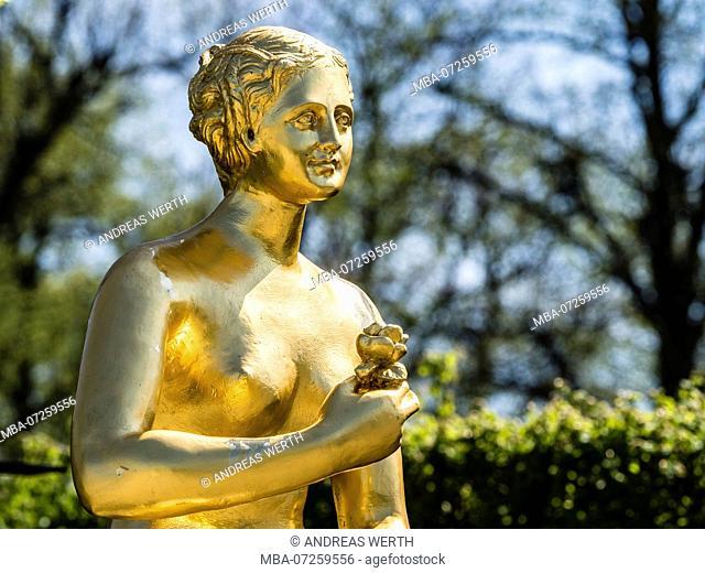 Golden sculpture, warrior with shield and sword, Herrenhausen Gardens, Baroque garden at castle Herrenhausen, Hanover, Germany