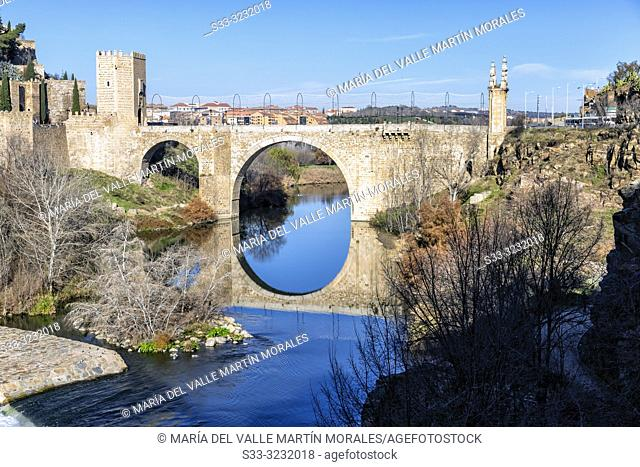 Medieval Alcantara bridge in Toledo and river Tajo. Spain. Europe
