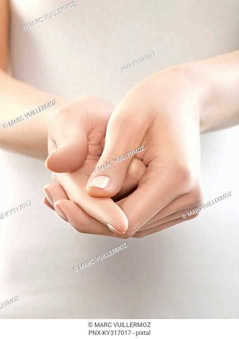 Woman pinching finger, close-up