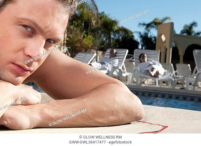 Man resting at the poolside