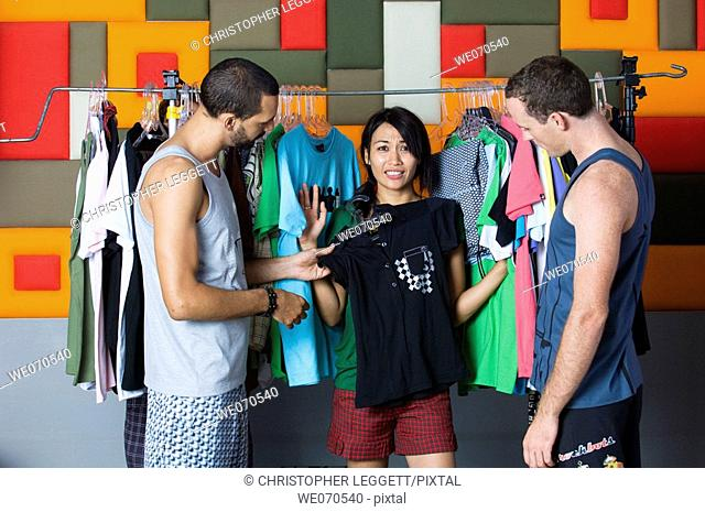 Young people selecting clothes