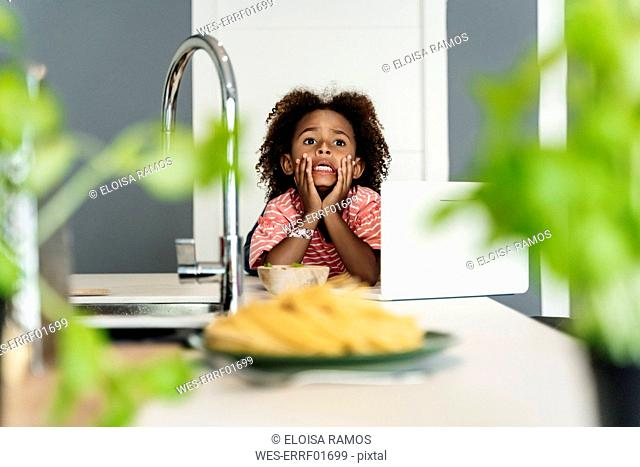 Girl with laptop in kitchen