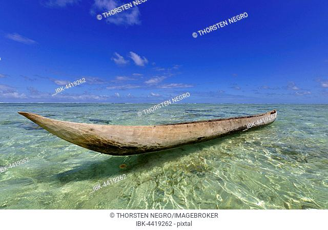 Traditional dugout boat on beach, Nosy Nato, eastern Madagascar, Madagascar