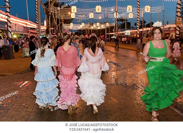 April Fair, Young women wearing a traditional flamenco dress, Seville, Region of Andalusia, Spain, Europe