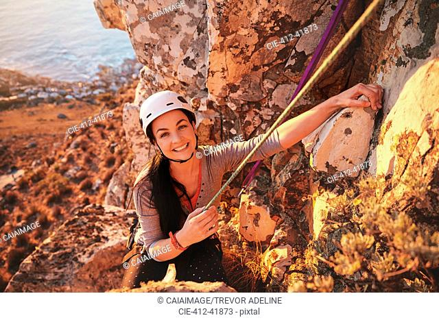 Portrait smiling, confident female rock climber