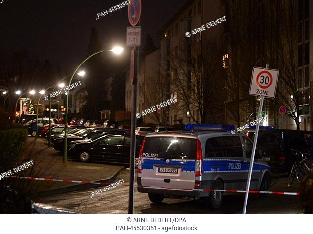 A police car is parked on a cordened off street in Frankfurt Main, Germany, 15 January 2014. A 25 year old man has taken an 18 year old woman hostage here with...