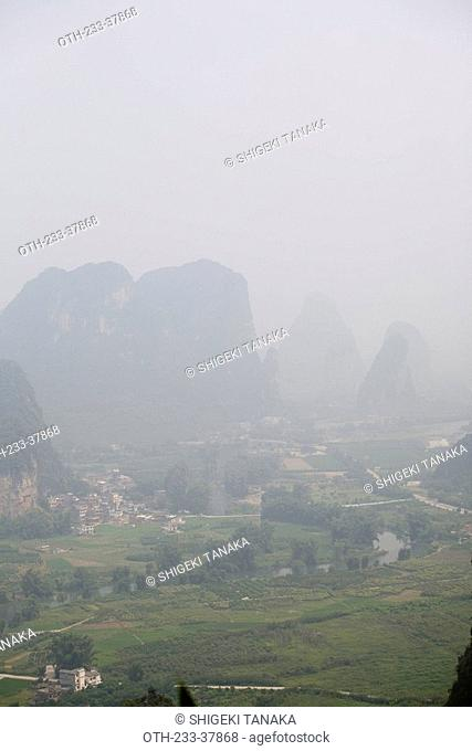 Overlooking the peaks and farmland from Moon Hill Yueliang shan, Yangshuo, Guilin, China