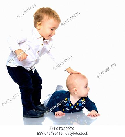 Toddler boy and girl, cute hugging in studio on a white background. The concept of a harmonious development of a child in the family, a happy childhood